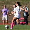DAVID LE/Staff photo. Swampscott sophomore Samantha Agresti plays the ball upfield against Beverly. 10/6/16.