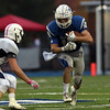 DAVID LE/Staff photo. Danvers senior captain lowers his shoulder and plows through the Peabody defense. 10/21/16