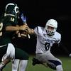 DAVID LE/Staff photo. Danvers senior Jack Anderson closes in on Lynn Classical quarterback Matt Lauria. 9/30/16.