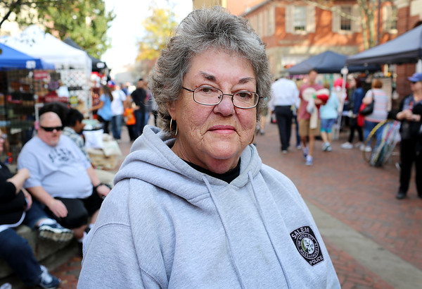 "HADLEY GREEN/Staff photo<br /> Rosemary O'Connor stands on Essex Street during Salem's ""Haunted Happenings"" on Saturday, October 7th. O'Connor is chairwoman of the Mack Park Neighborhood Association in Salem. 10/07/17"