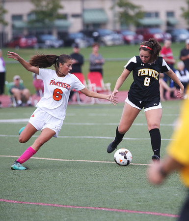HADLEY GREEN/Staff photo<br /> Bishop Fenwick's Marissa Orlando (8) and Beverly's Anna Edson (6) vie for the ball at the Beverly v. Bishop Fenwick varsity girls soccer game at the Hurd Stadium in Beverly. 10/07/17