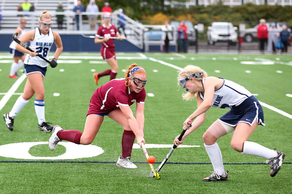 HADLEY GREEN/Staff photo<br /> Swampscott's Sarah Ryan (3) and Gloucester's Cate Delaney (8) fight for the ball at the Swampscott v. Peabody girls field hockey game at the Blocksidge Field in Swampscott.<br /> 10/26/17
