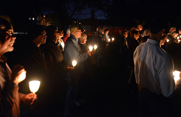 RYAN HUTTON/ Staff photo<br /> A few dozen people gather on the Beverly Common on Tuesday night for a candlelight vigil put on by the Beverly Multifaith Coalition for the recent mass shooting in Las Vegas.