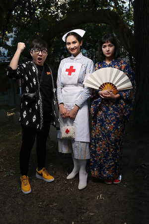 HADLEY GREEN/Staff photo<br /> From left, Natashanan Deeto, Emika Saeng, and Tanida Singhaklangpol of Boston explore the Charter Street Cemetery in downtown Salem on Halloween.<br /> <br /> 10/31/17