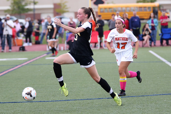 HADLEY GREEN/Staff photo<br /> Bishop Fenwick's Grace Foley (13) dribbles down the field while Beverly's Aly Barr (17) plays defense at the Beverly v. Bishop Fenwick varsity girls soccer game at the Hurd Stadium in Beverly. 10/07/17