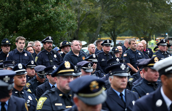 HADLEY GREEN/Staff photo<br /> Peabody police attended the ceremony to publicly unveil the new Peabody Police and Fire Memorial on Perkins Street. 10/14/17