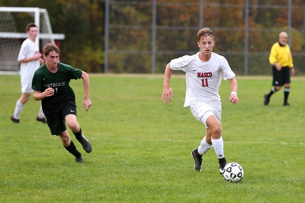 HADLEY GREEN/Staff photo<br /> Masconomet's Michael Budrewicz (11) dribbles towards the goal at the Masconomet v. Pentucket boys varsity soccer game at Masconomet High School.<br /> <br /> 10/24/17