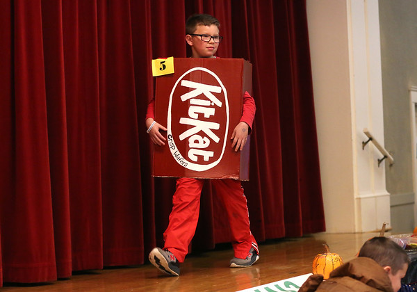 HADLEY GREEN/Staff photo<br /> Dressed as a KitKat, Jacob Diefenbach, 9, of Salem, walks across the stage at the Nightmare on Main Street costume party at the Knights of Columbus in Peabody.<br /> <br /> 10/25/17