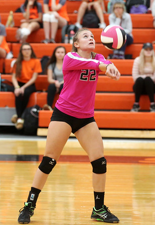 """HADLEY GREEN/Staff photo<br /> Beverly's Sophie McGarigal (22) returns the ball at the Beverly v. Winthrop girls volleyball """"Dig Pink"""" game. 10/06/17"""
