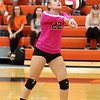 "HADLEY GREEN/Staff photo<br /> Beverly's Sophie McGarigal (22) returns the ball at the Beverly v. Winthrop girls volleyball ""Dig Pink"" game. 10/06/17"