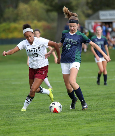HADLEY GREEN/Staff photo<br /> Pingree's Sydney Raess (18) fights for the ball at the Pingree v. Phillips Exeter girls soccer game at the Pingree School. 10/11/17