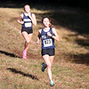HADLEY GREEN/Staff photo<br /> Peabody's Emily MacDonald sprints to the finish of the girls varsity race at the Northeastern Conference Cross Country championships at Bradley Palmer State Park.<br /> <br /> 10/28/17