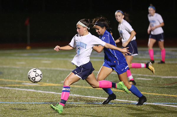 HADLEY GREEN/Staff photo<br /> Peabody's Emily Nelson (6) runs to gain control of the ball at the Peabody v. Danvers girls soccer game at Peabody High School.<br /> <br /> 10/25/17
