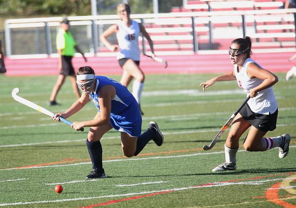 HADLEY GREEN/Staff photo<br /> Danvers' Erica Haibon (15) runs towards the ball at the Marblehead v. Danvers girls field hockey game.<br /> 09/30/17