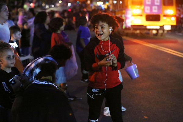 HADLEY GREEN/Staff photo<br /> Kids rush to pick up candy thrown from parade floats at the Annual Haunted Happenings Parade in downtown Salem. 10/05/17