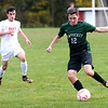 HADLEY GREEN/Staff photo<br /> Pentucket's Conor Logan (12) kicks the ball at the Masconomet v. Pentucket boys varsity soccer game at Masconomet High School.<br /> <br /> 10/24/17