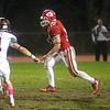HADLEY GREEN/Staff photo<br /> Masconomet's Dan Monagle (10) runs with the ball at the Masconomet v. Woburn football game at Masconomet High School.<br /> <br /> 10/27/17