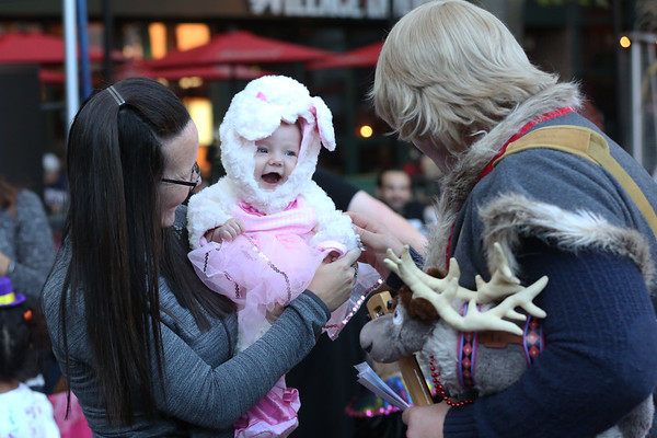 HADLEY GREEN/Staff photo<br /> Four-month-old Olivia Smith smiles at the annual Little Monsters Parade in downtown Salem. 10/18/17