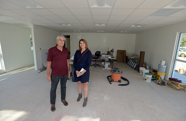 RYAN HUTTON/ Staff photo<br /> Michael Welch, left, and Meg Kubera, right, stand in the building they are developing on Loring Avenue in Salem which is connected to the Vesuvius restaurant.