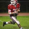 HADLEY GREEN/Staff photo<br /> Masconomet's Matt Brockelman (8) runs down the field at the Masconomet v. Woburn football game at Masconomet High School.<br /> <br /> 10/27/17