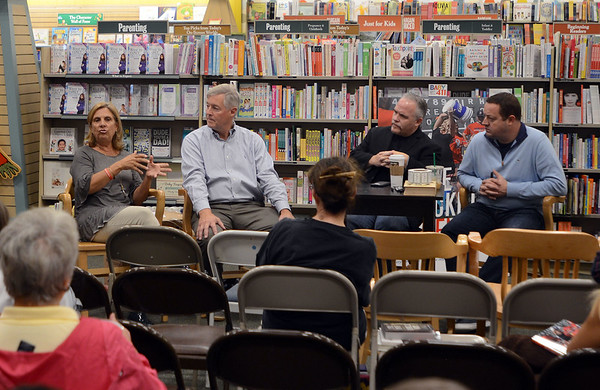 """RYAN HUTTON/ Staff photo<br /> Nancy and John Frates, left, are joined by authors Casey Sherman and Dave Wedge, right, in speaking with people at a book signing at the Peabody Barnes & Nobel for the Sherman's and Wedge's new book """"Ice Bucket Challenge: Pete Frates and the Fight Against ALS"""" - the story of Nancy and John's son Pete."""