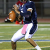 HADLEY GREEN/Staff photo<br /> Peabody's Jonell Espinal (3) looks to throw the ball at the Peabody v. Masconomet varsity football game. 10/06/17