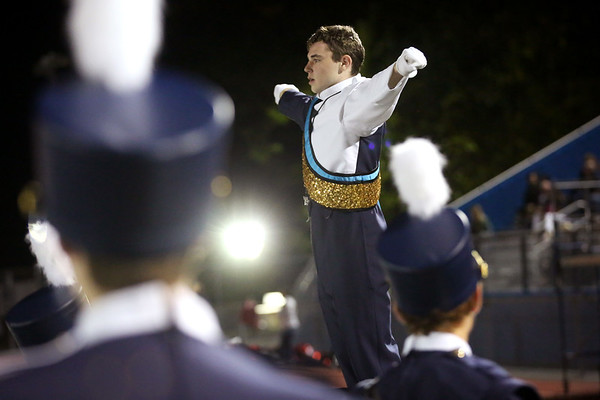 """HADLEY GREEN/Staff photo<br /> Peabody senior Tim Serino conducts the Peabody High School marching band in a rousing rendition of """"Crocodile Rock"""" at the Peabody v. Masconomet varsity football game halftime show. 10/06/17"""