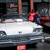 HADLEY GREEN/Staff photo<br /> People look at a 1959 Ford Galaxie Sunliner at the annual classic car show and craft fair along Main Street in Peabody. 10/07/17