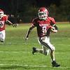 HADLEY GREEN/Staff photo<br /> Masconomet's Matt Brockelman (8) sprints with the ball to make a touchdown at the Masconomet v. Woburn football game at Masconomet High School.<br /> <br /> 10/27/17