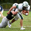 HADLEY GREEN/Staff photo<br /> Hamilton-Wenham's Phillip Durgin (22) tackles Manchester-Essex's Robbie Sarmanian (8) at the Hamilton-Wenham v. Manchester-Essex football game at Hamilton-Wenham. 10/14/17