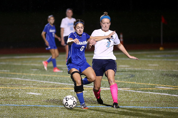 HADLEY GREEN/Staff photo<br /> Danvers' Hannah Lejeune (8) runs towards the ball while Peabody's Emily Nelson (6) plays defense at the Peabody v. Danvers girls soccer game at Peabody High School.<br /> <br /> 10/25/17