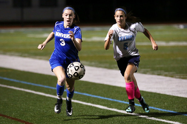 HADLEY GREEN/Staff photo<br /> Peabody's Emma Darling (5) and Danvers' Sarah McCarriston (3) sprint towards the ball at the Peabody v. Danvers girls soccer game at Peabody High School.<br /> <br /> 10/25/17