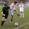 HADLEY GREEN/Staff photo<br /> Masconomet's Josh Rubin (16) and Pentucket's Patrick Dillon (11) vie for the ball at the Masconomet v. Pentucket boys varsity soccer game at Masconomet High School.<br /> <br /> 10/24/17