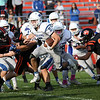 HADLEY GREEN/Staff photo<br /> Danvers' Matt McCarthy (5) charges through Beverly defenders at the Beverly v. Danvers football game at the Hurd Stadium in Beverly. 10/14/17