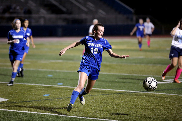 HADLEY GREEN/Staff photo<br /> Danvers' Riley Baker (19) moves the ball out of her team's end zone at the Peabody v. Danvers girls soccer game at Peabody High School.<br /> <br /> 10/25/17