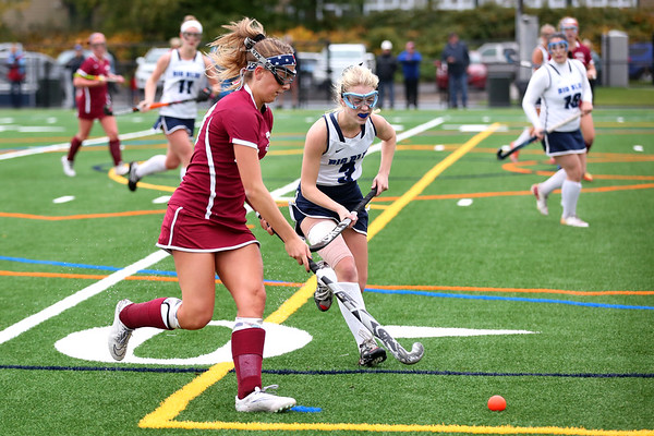 HADLEY GREEN/Staff photo<br /> Gloucester's Gabby Machado (10) runs with the ball while Swampscott's Sarah Ryan (3) plays defense at the Swampscott v. Peabody girls field hockey game at the Blocksidge Field in Swampscott.<br /> 10/26/17