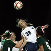 DAVID LE/Staff photo. Essex Tech freshman Virginia Vienneau (39) leaps high above a few Manchester-Essex players to clear a header on a corner kick. 11/4/15. ORG XMIT: nxbf1k77