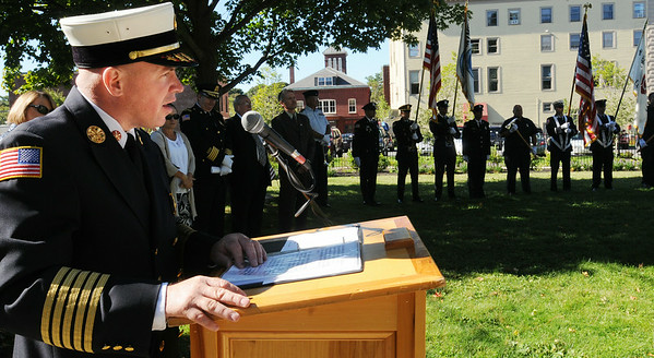 Marblehead Fire Chief Jason  Gilliland begins the remembrance ceremony to commemorate the 11-year anniversary of the Sept. 11, 2001, terrorist attacks. The ceremony was held at Memorial Park.<br /> Photo by Ken Yuszkus/The Salem News, Tuesday, Sept. 11, 2012.