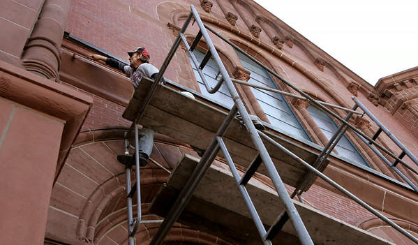 Beverly:<br /> Tim Cervera is part of the crew that is replastering and repainting St. Mary Star of the Sea church on Cabot Street in Beverly.<br /> Photo by Ken Yuszkus/The Salem News, Thursday, September 20, 2012.