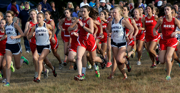 Topsfield:<br /> A few seconds into the start of the girls race at the Masconomet vs. Hamilton-Wenham cross country meet held at Bradley Palmer State Park.<br /> Photo by Ken Yuszkus/The Salem News, Monday, September 24, 2012.