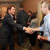 Republican congressional candidate Richard Tisei, left, shakes hands as he arrives at the Salem Waterfront Hotel for a rally on primary election night, despite running unopposed for the Republican nomination. DAVID LE/Staff photo. 9/9/14.