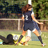 Danvers senior goalie Amanda Backe, left, makes a lunging sliding save on Swampscott senior Nikki Rose (2) on a breakaway attempt on Wednesday afternoon. DAVID LE/Staff photo. 9/3/14.