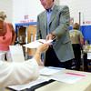 KEN YUSZKUS/Staff photo. Congressman John Tierney received his ballot to vote at the Bentley Elementary School in Salem. 9/9/14
