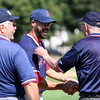 Peabody High School great and former Boston Red Sox catcher Steve Lomasney smiles and shakes hands with the umpires prior to the start of the 58th annual Peabody/Lynnfield Police vs Old Timers baseball game to raise money for Cops For Kids with Cancer and the Jimmy Fund on Monday morning. DAVID LE/Staff photo. 9/1/14.