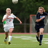 Beverly freshman Chloe Becker (9) and Peabody back Katherine Scacchi, right, race after a loose ball on Thursday afternoon. DAVID LE/Staff photo. 9/11/14.
