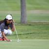 Beverly senior golfer Sarah Daley lines up a putt. DAVID LE/Staff photo. 9/18/18.