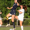 Swampscott senior Nikki Rose (2) leaps in front of Danvers senior captain Becca Horn (22) to break up a clearing attempt on Wednesday afternoon. DAVID LE/Staff photo. 9/3/14.