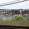 KEN YUSZKUS/Staff photo. The wall of graffiti along the railroad tracks in Beverly.