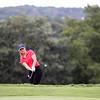 Salem High School golfer Madison Ballou chips uphill onto the green. DAVID LE/Staff photo. 9/18/18.