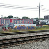 KEN YUSZKUS/Staff photo. The wall of graffiti along the railroad tracks in Beverly.